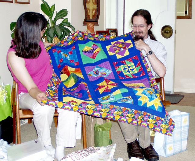 Cathy and Chris with quilt top
