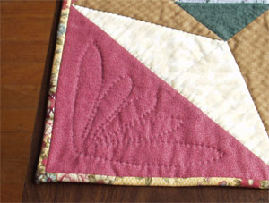 Detail of the quilting in the setting triangles